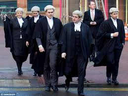 Barristers Dressed in Wigs And Gowns